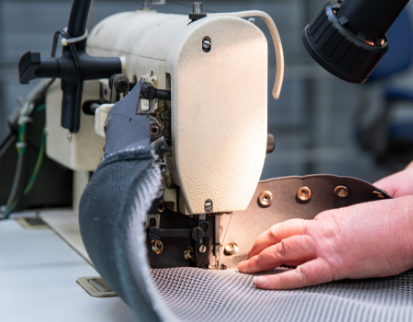 A textile prototype being sewn.