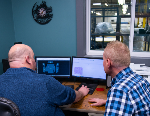 A Fairway Products textile prototyping pro reviews a digital rendering of a prototype.