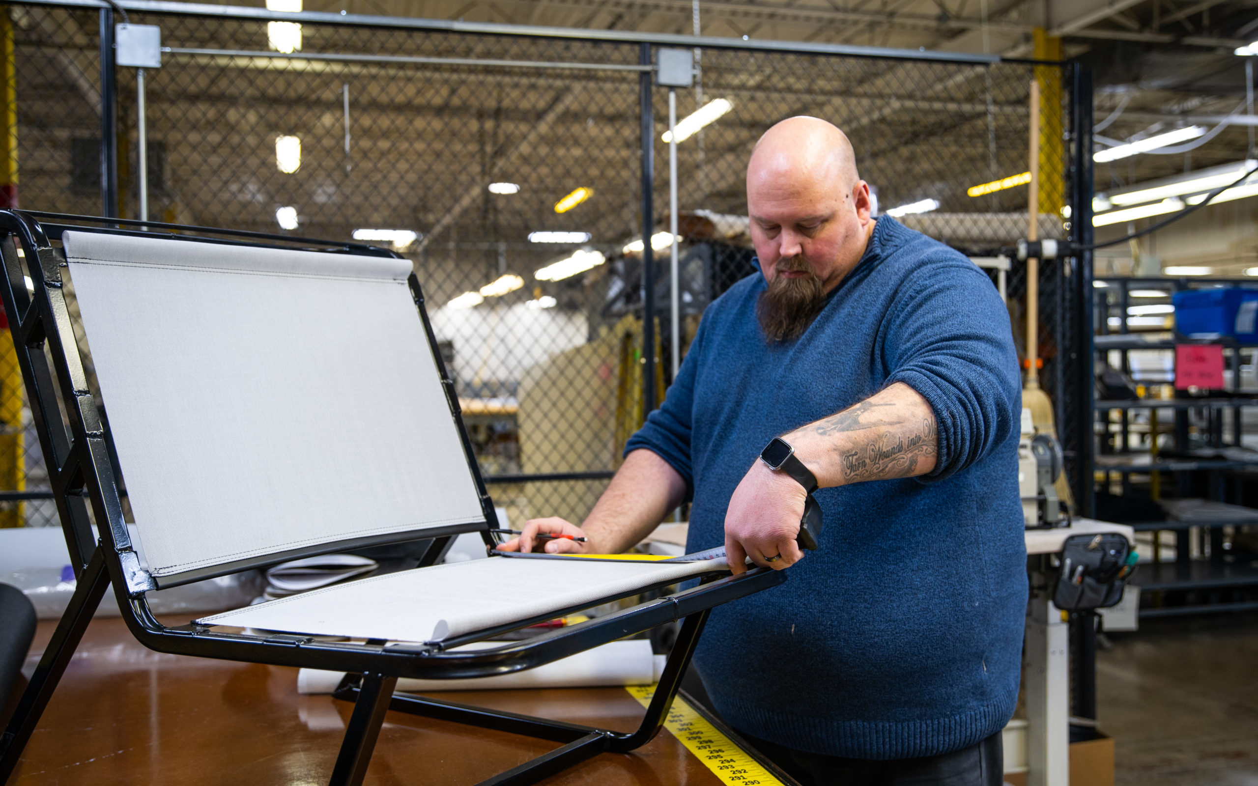 A textile prototyping expert crafts a prototype chair.